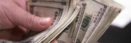 A gambler counts out cash